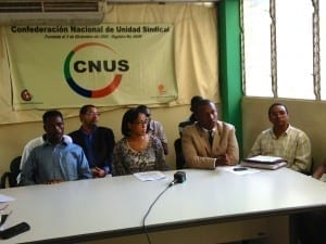 Dominican unionists and Haitian workers seek justice for unpaid coconut plant workers. Credit: Geoff Herzog
