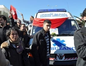 Tunisians accompany the ambulance carrying Belaid's body. Credit: Sarah Mersch