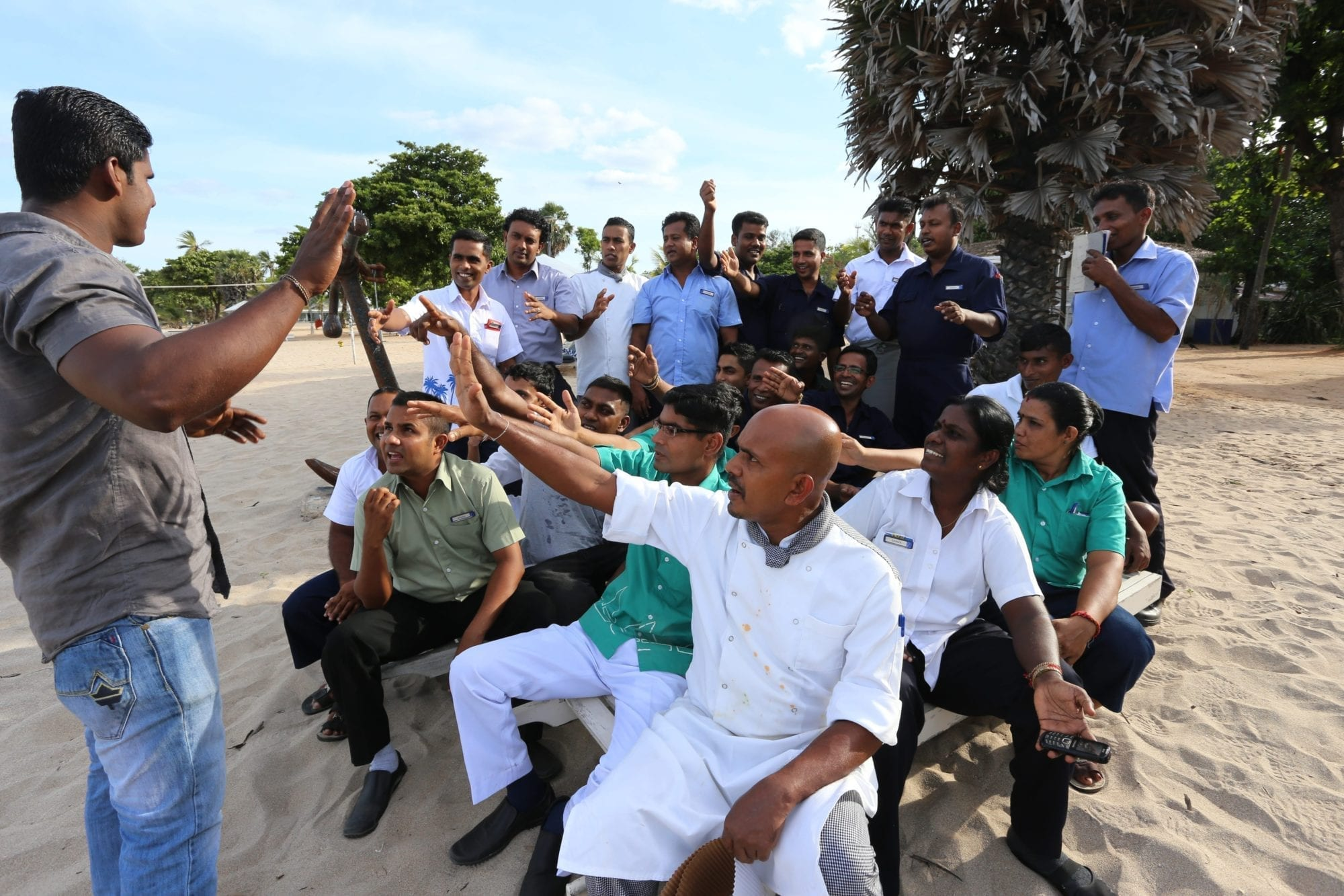 Sri Lanka hotel workers meet with a union shop steward on the beach