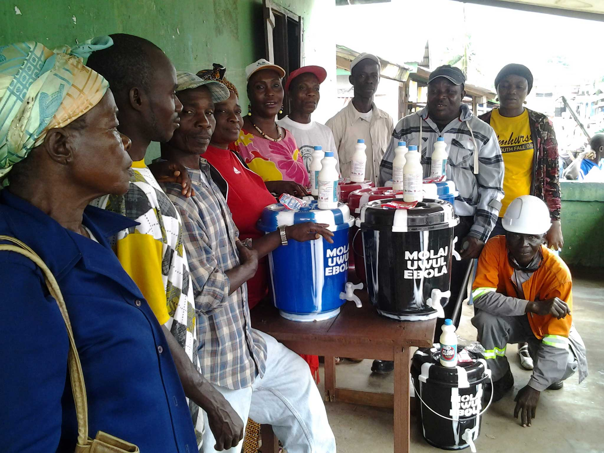 Union members are distributing buckets of chlorine to workers around Liberia.
