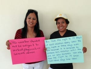 Jordan.Filipina domestic worker participants in a combatting trafficking in persons training June 2014, holding signs with their rights under Jordanian law2.fr.crop
