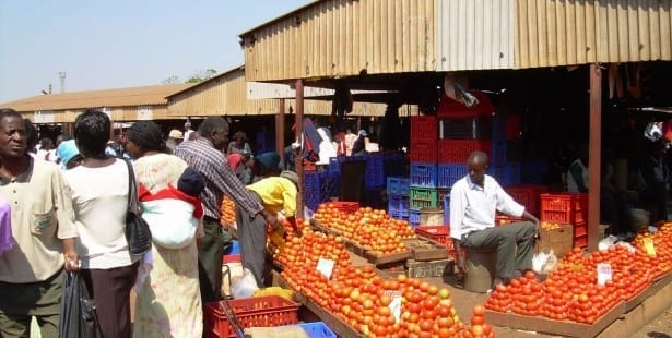 In Harare, Zimbabwe, a market vendor sells produce