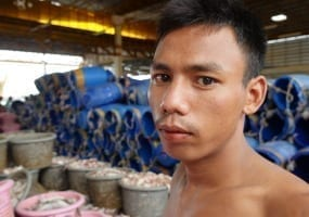 Burmese dockworkers in Thailand are paid between $9 and $18 a day. Credit: Solidarity Center/Jeanne Hallacy