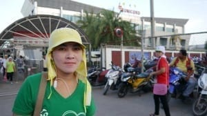 A Burmese migrant worker outside the fish canning factory where she works. Credit: Solidarity Center/Jeanne Hallacy