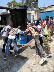 Haiti, workers washing hands outside garment factory, worker rights, unions, Solidarity Center
