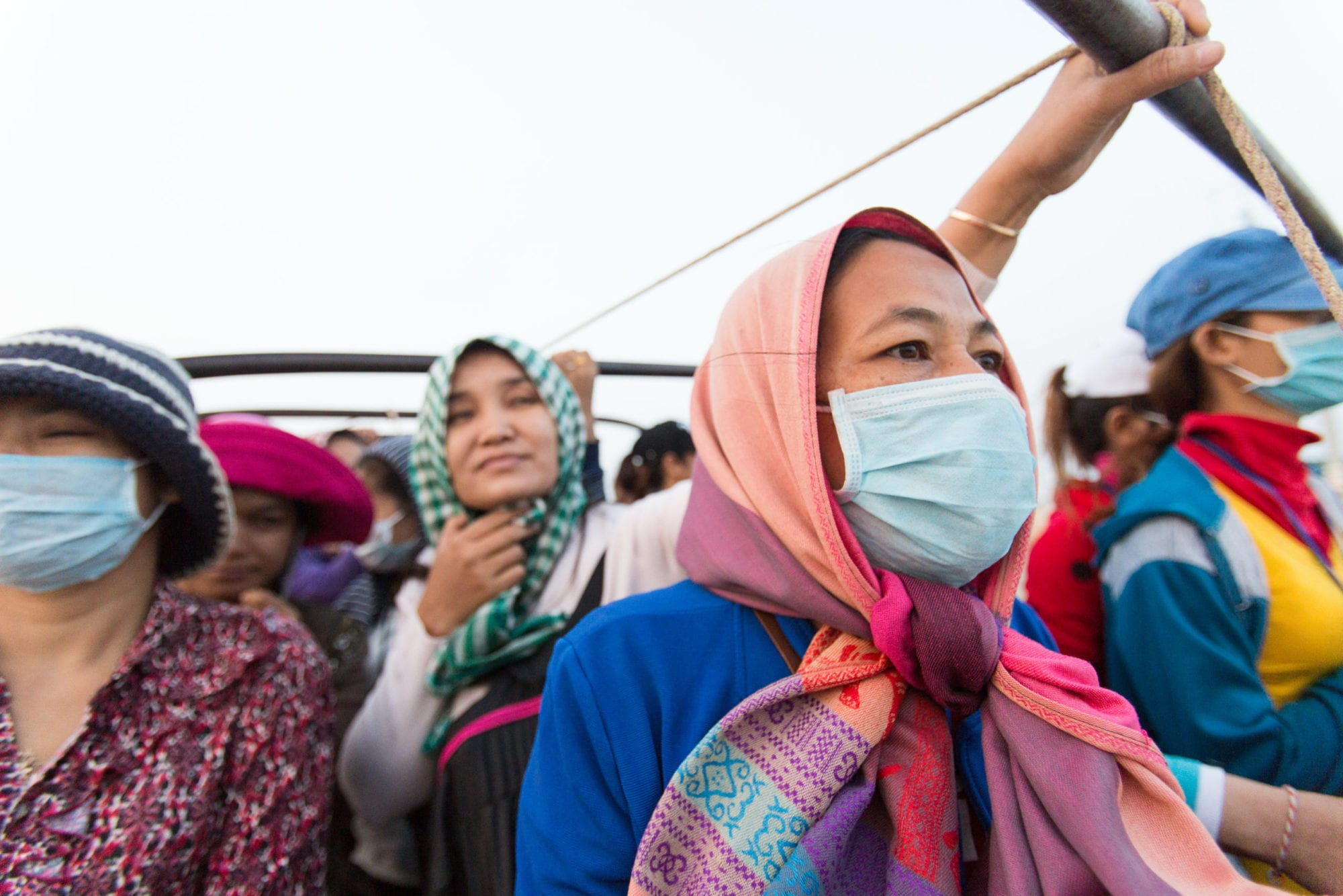 Cambodia, garment workers traveling in open truck to work, Solidarity Center, worker rights, human rights